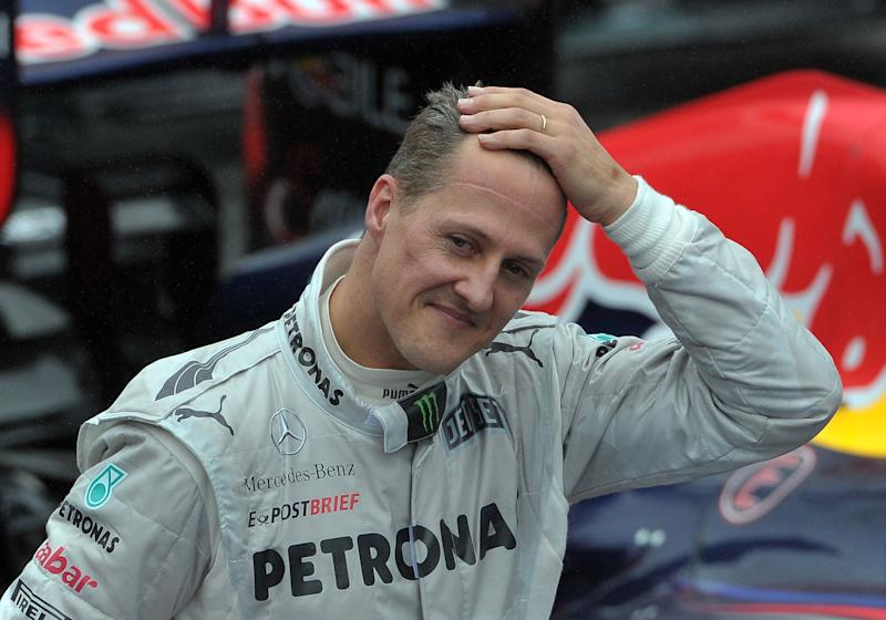 German Formula One driver Michael Schumacher gestures at the end of the Brazil's F-1 GP on November 25, 2012 at the Interlagos racetrack in Sao Paulo, Brazil. AFP PHOTO/YASUYOSHI CHIBA (Photo credit should read YASUYOSHI CHIBA/AFP/Getty Images)