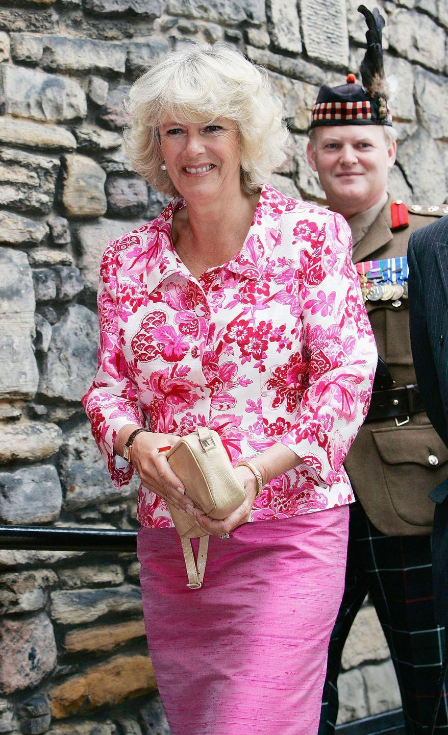"""<p><a href=""""https://www.townandcountrymag.com/society/tradition/g36433449/princess-diana-queen-elizabeth-royals-in-florals-photos/"""" rel=""""nofollow noopener"""" target=""""_blank"""" data-ylk=""""slk:Royals love florals"""" class=""""link rapid-noclick-resp"""">Royals love florals</a>, as Camilla showed in this pink floral top and pink skirt combo at Edinburgh Castle in 2005.</p>"""