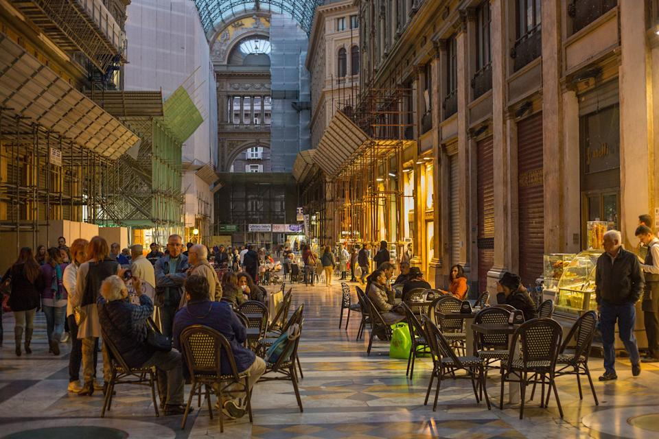 NAPLES, ITALY - OCTOBER 31, 2015: Unknown people resting in the Galleria Umberto I at evening. Galleria Umberto is a public shopping gallery. It was built between 1887–1891. (Photo: Kutredrig via Getty Images)
