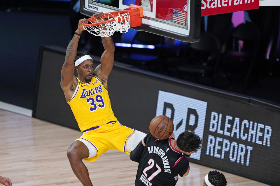 Los Angeles Lakers center Dwight Howard dunks on Jusuf Nurkic of the Portland Trail Blazers as the Lakers rallied to eliminate the Blazers. (AP Foto/Ashley Landis)