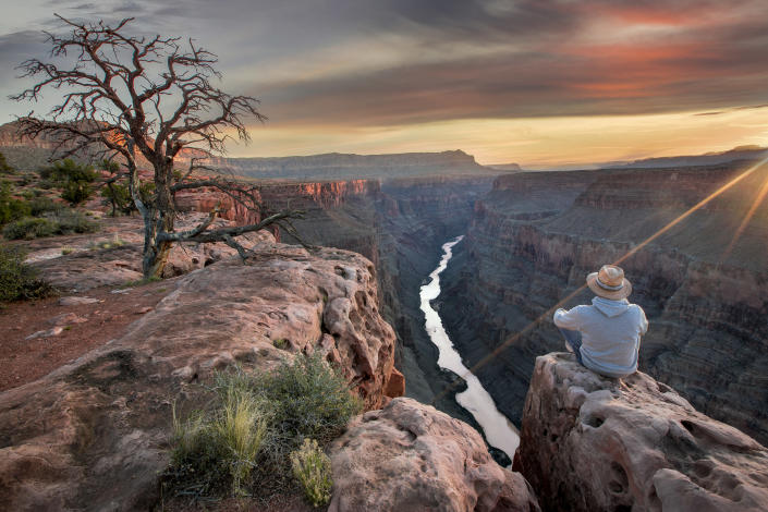 A hiker takes in a view of the Grand Canyon. (Photo: Marcel Fischer/Getty Images)