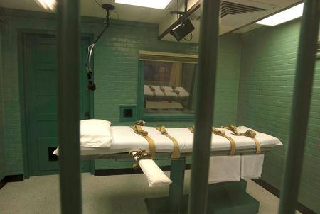 FILE PHOTO: The death chamber is seen through the steel bars from the viewing room at the state penitentiary in Huntsville