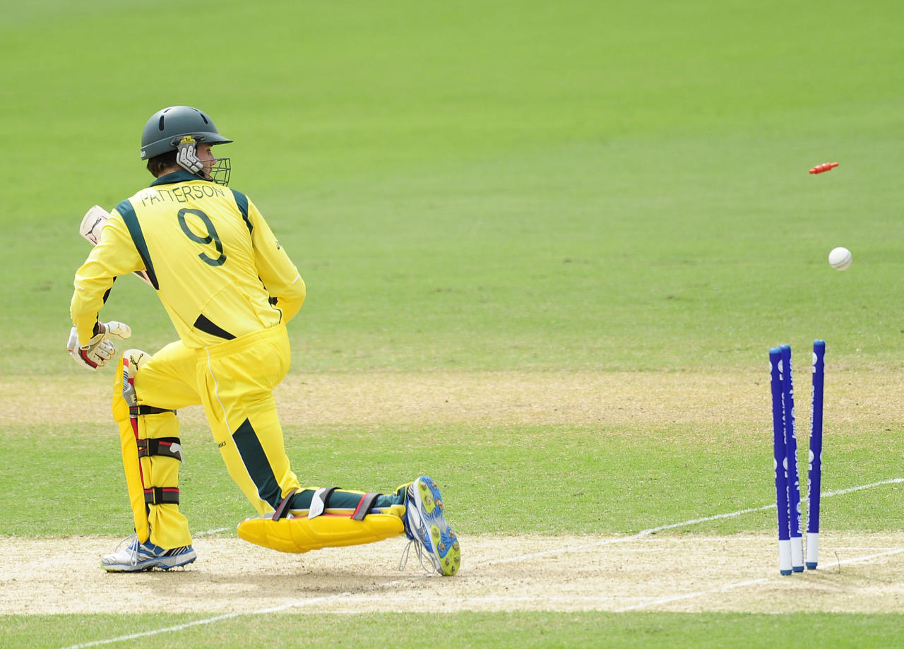 TOWNSVILLE, AUSTRALIA - AUGUST 26:  Kurtis Patterson of Australia is bowled out during the 2012 ICC U19 Cricket World Cup Final between Australia and India at Tony Ireland Stadium on August 26, 2012 in Townsville, Australia.  (Photo by Ian Hitchcock-ICC/Getty Images)