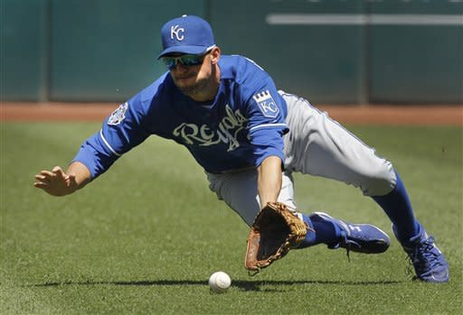 Kansas City Royals right fielder Jeff Francoeur cannot catch an RBI fly ball by Cleveland Indians' Casey Kotchman in the second inning of a baseball game in Cleveland on Wednesday, May 30, 2012. Indians' Shelley Duncan scored on the play. (AP Photo/Amy Sancetta)