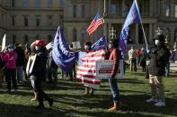People protest against election results in Lansing, Michigan