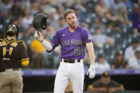 Colorado Rockies' Ryan McMahon reacts after striking out against San Diego Padres starting pitcher Dinelson Lamet to end the third inning of a baseball game Monday, June 14, 2021, in Denver. (AP Photo/David Zalubowski)