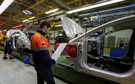 FILE PHOTO: Employees work on an assembly line at a Ford Sollers, U.S. carmaker Ford's joint venture with Russian partners, factory in Vsevolozhsk, Leningrad region, Russia July 7, 2015. Picture taken July 7, 2015. REUTERS/Igor Russak/File Photo