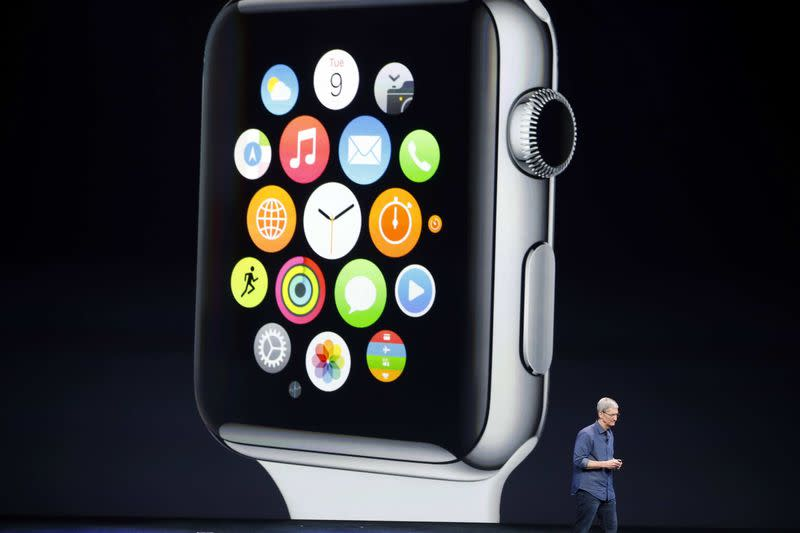 File photo of Apple CEO Tim Cook speaking during an Apple event announcing the Apple Watch at the Flint Center in Cupertino