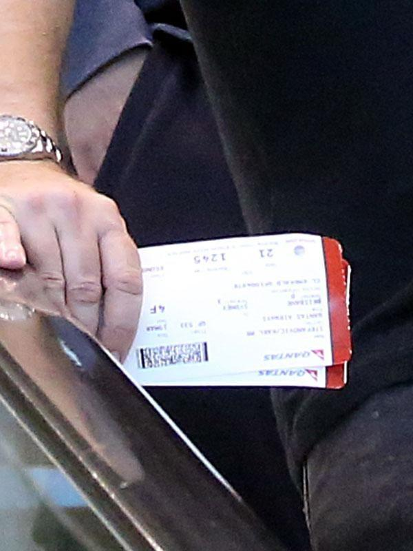 Karl holding two boarding passes whilst exiting Sydney airport. Source: Diimex