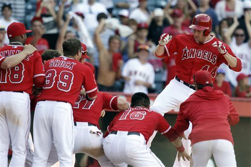 Los Angeles Angels' Mark Trumbo, right, celebrates his walk-off home run against the Detroit Tigers during the 13th inning of a baseball game in Anaheim, Calif., Sunday, April 21, 2013. The Angels won 4-3. (AP Photo/Chris Carlson)