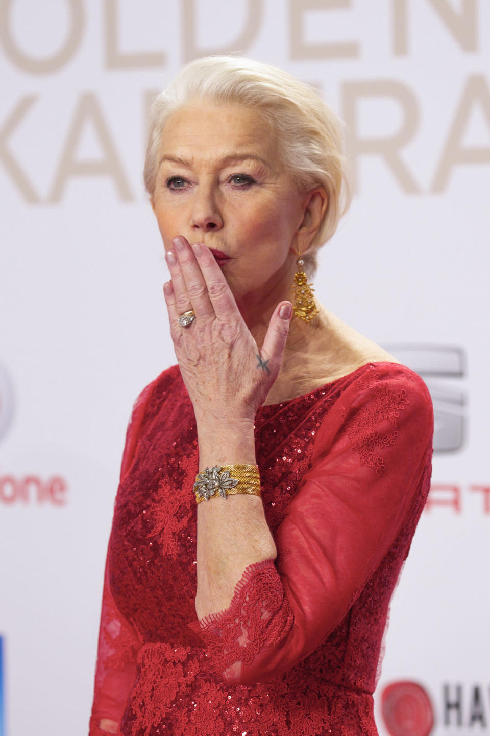 <p>In case you needed another reason to love Helen Mirren, the actress got a tattoo done with a safety pin (ouch!) while drunk. The interlocking Vs mean 'equal and opposite' with the notion that two people can be different but still has equal value to yourself. <em>[Photo: Getty]</em> </p>