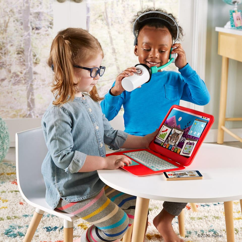 The Fisher-Price My Home Office Set ($24.99, available for pre-order) comes with a toy laptop with changeable fabric apps for the screen, toy smartphone, headset and coffee cup.