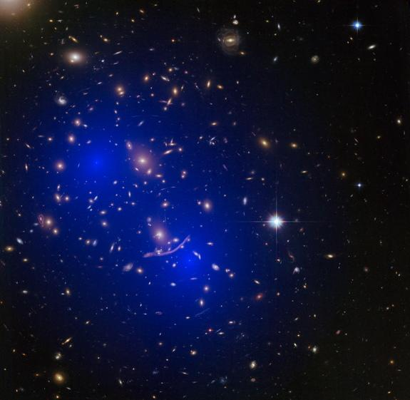 An image of galaxy merger A370, overlaid with a model of the dark matter present. Scientists have used galaxy mergers to narrow down the possible makeup of dark matter.