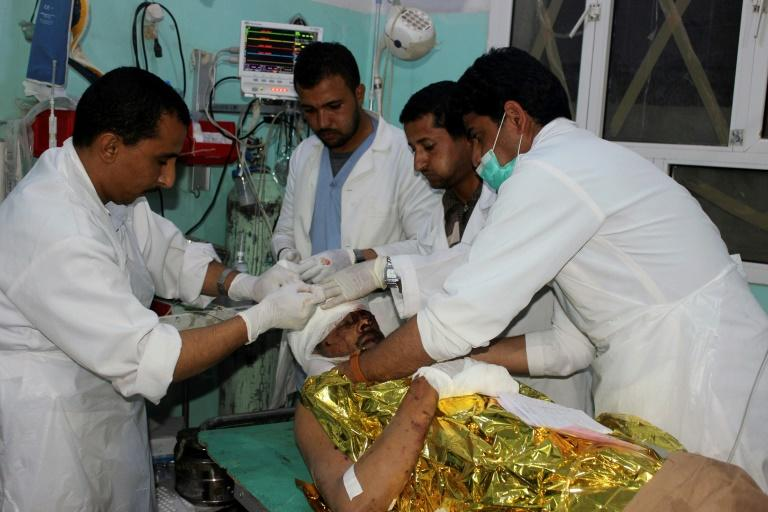 Doctors treat a Yemeni men in the rebel stronghold of Saada on November 20, 2018 following a reported air strike