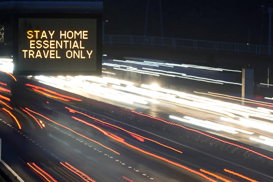 KNUTSFORD, ENGLAND - NOVEMBER 11: (EDITORS NOTE: Image was created using a long exposure) In this long exposure photograph, an electronic matrix sign informs motorists on the M6 in Cheshire 'Stay Home Essential Travel Only' on November 11, 2020 in Knutsford, United Kingdom. England enters the second national coronavirus lockdown today. People are still permitted to exercise with one other person, takeaway food is permitted but bars and restaurants are shut for sit-in service. Schools will remain open but people are being advised to work from home where possible and only undertake necessary travel. All non-essential shops are closed with supermarkets and builders' merchants remaining open. (Photo by Christopher Furlong/Getty Images)