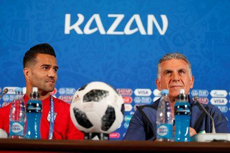 Soccer Football - World Cup - Iran Press Conference - Kazan Arena, Kazan, Russia - June 19, 2018 Iran coach Carlos Queiroz and Masoud Shojaei during the press conference REUTERS/John Sibley