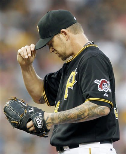 Pittsburgh Pirates starting pitcher A.J. Burnett tugs at his cap after Chicago Cubs' Luis Valbuena scored on a single by Alfonso Soriano during the first inning of a baseball game Friday, Sept. 7, 2012, in Pittsburgh. (AP Photo/Keith Srakocic)