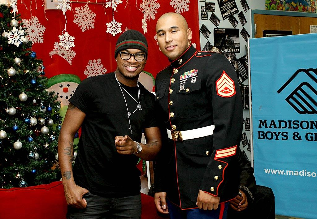 """Also making dreams a reality was R&B singer Ne-Yo (pictured with Staff Sergeant Ivan LeBron), who helped hand out toys, clothes, video games, and other donated gifts at Compound Entertainment's 3rd Annual Giving Tour at the Madison Square Boys & Girls club in NYC. Steve Mack/<a href=""""http://www.gettyimages.com/"""" target=""""new"""">GettyImages.com</a> - December 19, 2010"""
