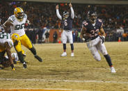 Chicago Bears running back Matt Forte (22) runs into end zone for a touchdown as quarterback Jay Cutler (6) reacts during the second half of an NFL football game against the Green Bay Packers, Sunday, Dec. 29, 2013, in Chicago. At left is Packers linebacker Mike Neal (96). (AP Photo/Charles Rex Arbogast)