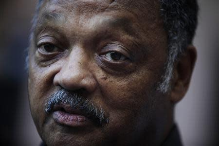 Civil rights activist Jesse Jackson talks to the media at the National hotel in Havana