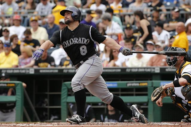 Colorado Rockies' Michael McKenry hits a solo home run off Pittsburgh Pirates starting pitcher Jeff Locke during the second inning of a baseball game in Pittsburgh Sunday, July 20, 2014. (AP Photo/Gene J. Puskar)