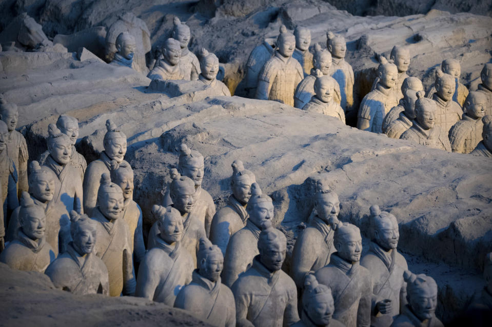 Excavated terracotta figures are seen at the Museum of Terracotta Warriors and Horses of Emperor Qin Shihuang in Xi'an in northwestern China's Shaanxi Province in Xi'an, Monday, Jan. 8, 2018. (AP Photo/Mark Schiefelbein)