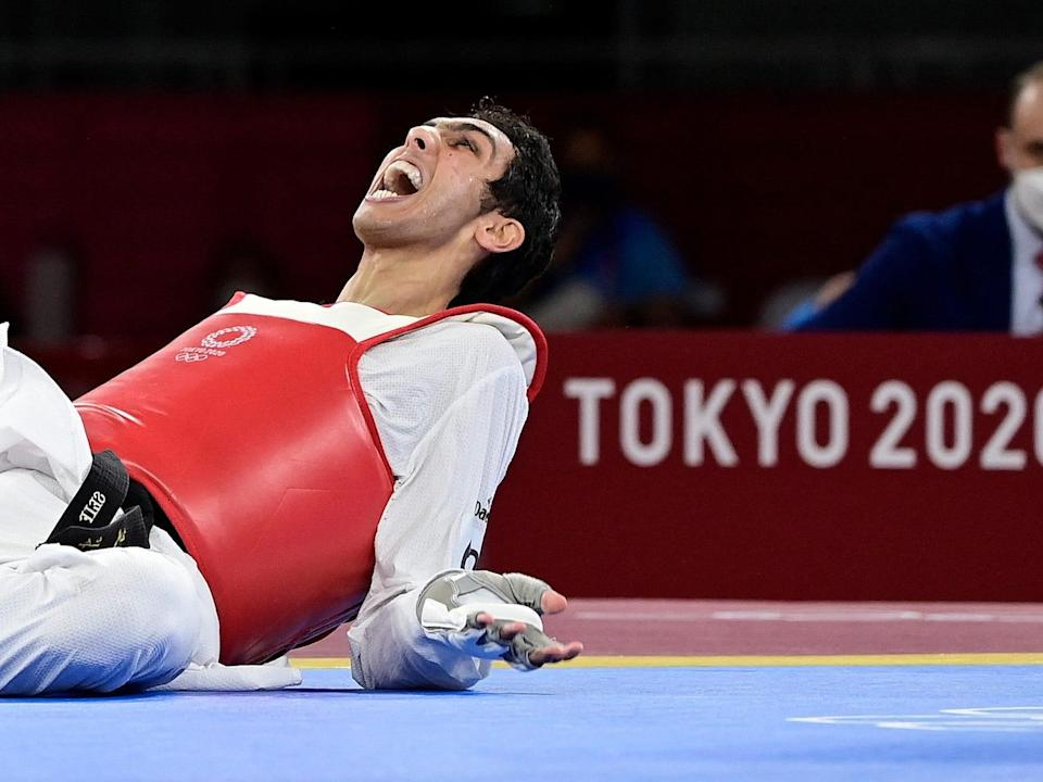 Egypt's Seif Eissa celebrates after winning bronze in taekwondo at the Tokyo Olympics.