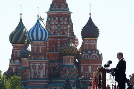FILE PHOTO: Russian President Vladimir Putin delivers a speech during the Victory Day parade, marking the 71st anniversary of the victory over Nazi Germany in World War Two, at Red Square in Moscow, Russia, May 9, 2016.  REUTERS/Grigory Dukor/File Photo