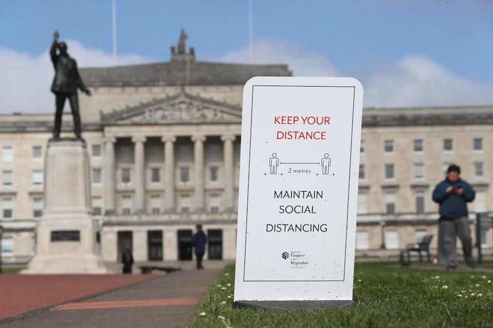 File photo dated 01/04/21 of a social distancing sign in the Stormont Estate in Belfast. Stormont ministers will meet later to consider further Covid-19 relaxations for Northern Ireland and discuss ways to tackle the region's spiralling health waiting lists. Issue date: Monday July 26, 2021.