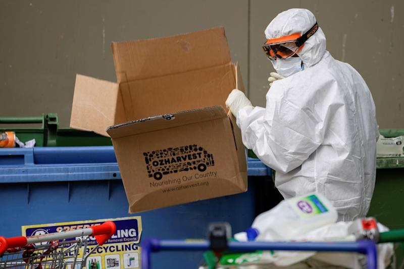 A worker dressed in personal protective equipment disposes of rubbish outside a public housing tower, reopened the previous night after being locked down in response to an outbreak of the coronavirus disease (COVID-19), in Melbourne, Australia, July 10, 2020. REUTERS/Sandra Sanders (Photo: REUTERS)