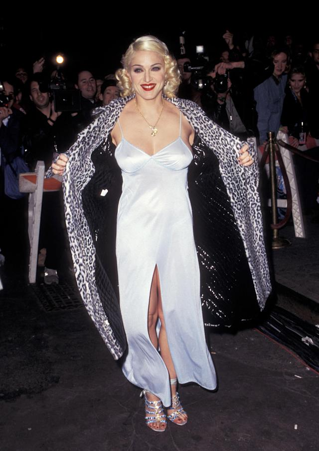 <p>A satin silk dress (cut almost to the crotch) was paired with a leopard print coat during a night out in the mid-90s. <em>[Photo: Getty]</em> </p>