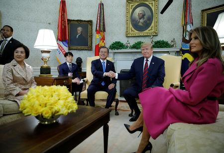 U.S. President Donald Trump shakes hands with South Korea's President Moon Jae-in as the president and first lady Melania Trump meet with Moon and his wife Kim Jung-sook in the Oval Office at the White House in Washington, U.S., April 11, 2019. REUTERS/Carlos Barria