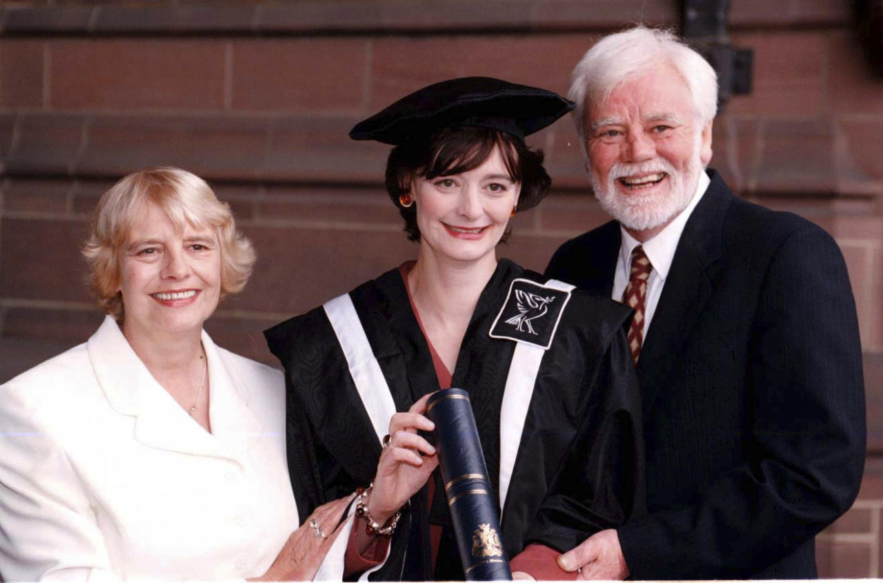 """FILE - In this July 15, 1997 file photo, Cherie Booth with her parents Gale and Tony Booth after receiving an honorary fellowship from John Moore's University in Liverpool, England. British actor Tony Booth, father-in-law of former Prime Minister Tony Blair, has died aged 85. Booth's family says he died late Monday, Sept. 25, 2017 after suffering from Alzheimer's disease and heart problems. Booth had his most enduring role as the left-wing son-in-law of a bigoted father in the sitcom """"Till Death Us Do Part."""" The show ran for almost a decade from 1966 and inspired the American series """"All in the Family."""" (Peter Wilcock/PA via AP, file)"""
