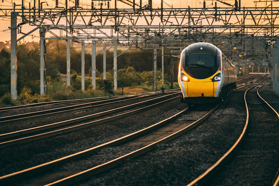Pendolino passes as the sun set in the background