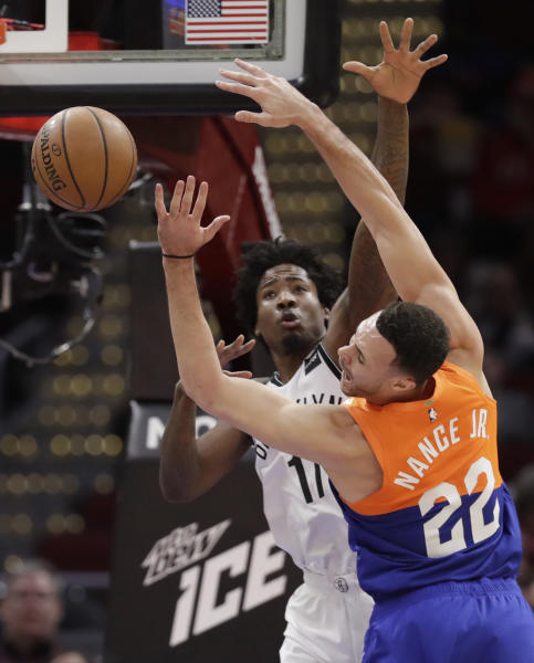 Cleveland Cavaliers' Larry Nance Jr. (22) is stopped by Brooklyn Nets' Ed Davis (17) in the first half of an NBA basketball game, Wednesday, Feb. 13, 2019, in Cleveland. (AP Photo/Tony Dejak)