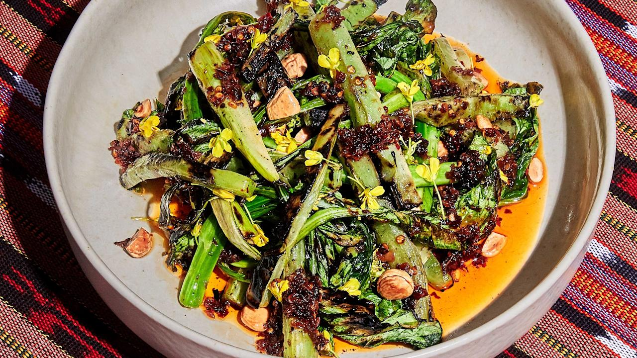 """If you can't find yu choy, a slightly bitter green in the brassica family that's often available at Asian markets, don't be discouraged: The fiery sate oil complements any grilled vegetable. <a href=""""https://www.bonappetit.com/recipe/grilled-yu-choy-with-sate-oil?mbid=synd_yahoo_rss"""">See recipe.</a>"""