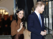 FILE - In this Tuesday, Jan. 7, 2020 file photo, Britain's Prince Harry and Meghan, Duchess of Sussex smile as they leave Canada House, in London. Prince Harry and his wife Meghan 'stepping back' as senior UK royals, will work to become financially independent, they announced Wednesday, Jan. 8, 2020.(Daniel Leal-Olivas/Pool Photo via AP, file)