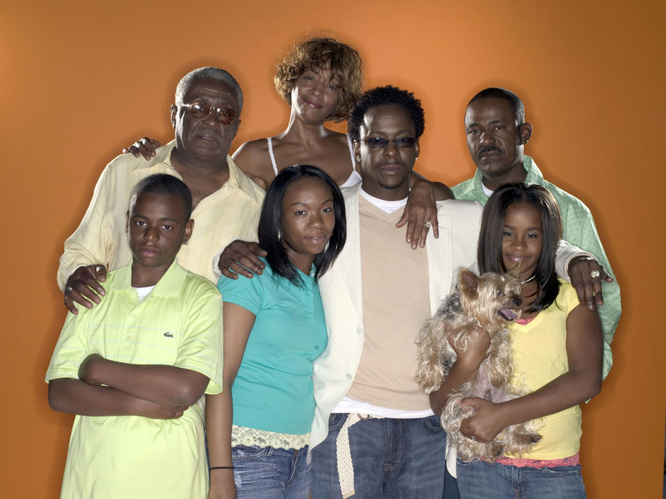 BEING BOBBY BROWN -- Pictured: (back row l-r) Pops Brown, Whitney Houston, Tommy Brown (front row l-r) Bobby Brown Jr., La'princia Brown, Bobby Brown, Bobbi Kristina Brown  (Photo by F. Scott Schafer/NBCU Photo Bank/NBCUniversal via Getty Images via Getty Images)