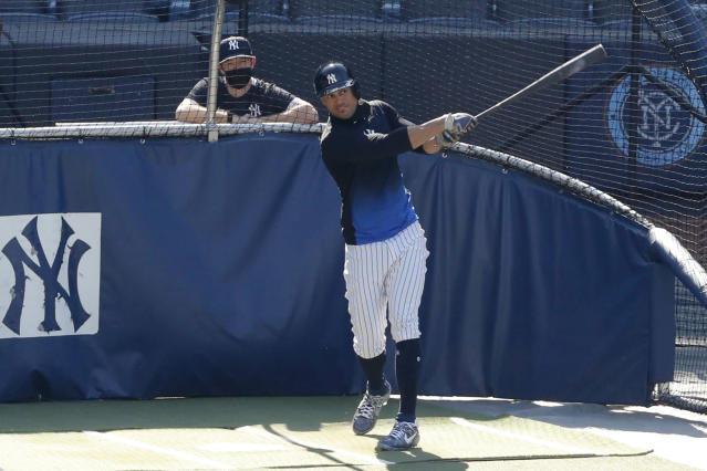 FILE - In this July 5, 2020, file photo, New York Yankees designated hitter Giancarlo Stanton bats during summer baseball training at Yankee Stadium in New York. Nothing changes the New York Yankees' mission, not the novel coronavirus, not a 60-game regular season. Winning the World Series is the sole focus. (AP Photo/Kathy Willens)