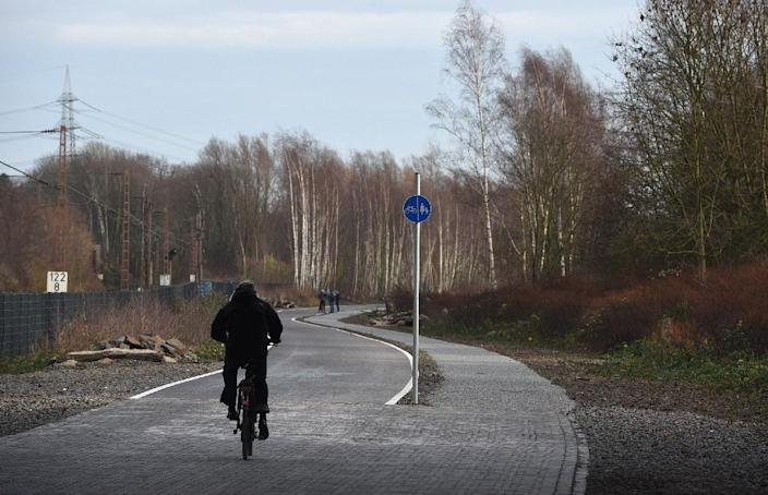 A cyclist enjoys the first five-kilometre (three-mile) stretch of a bicycle highway in Mulheim an der Ruhr, which will connect 10 western cities including Duisburg, Bochum and Hamm and four universities (AFP Photo/Patrik Stollarz)
