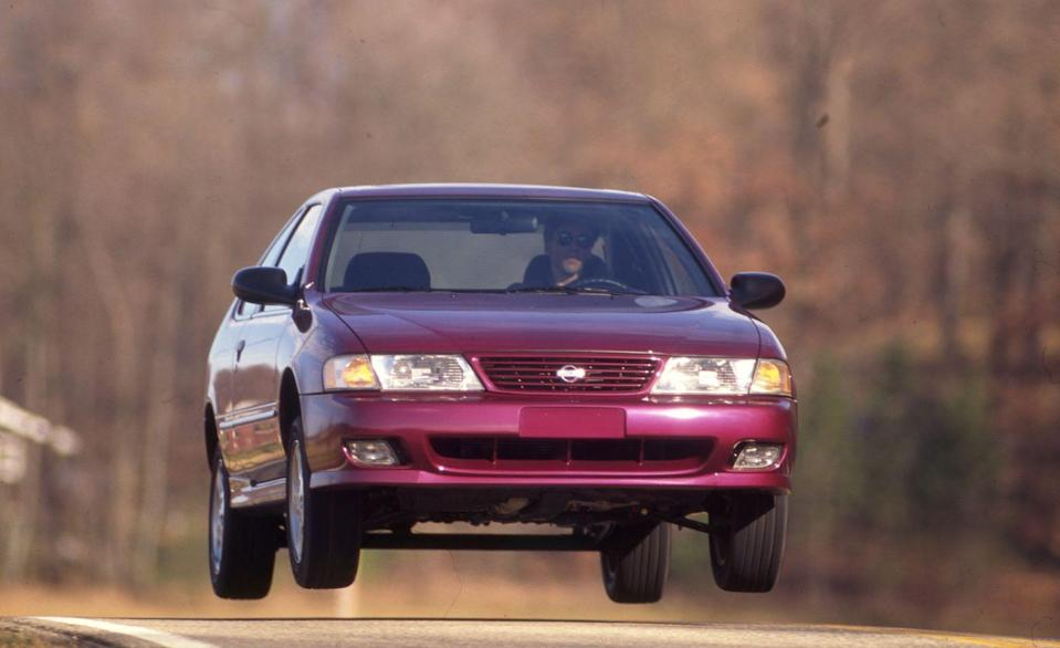 """<p>Forget the half-foot or so of air under the Nissan Sentra 200SX's tires. Just check out that void between the coupe's twist-beam rear axle and the underbody! This photo was the perfect match for <a href=""""http://www.caranddriver.com/flipbook/formula-cd-the-car-and-driver-covers-of-the-1990s#63"""" rel=""""nofollow noopener"""" target=""""_blank"""" data-ylk=""""slk:the cover of our February 1995 issue"""" class=""""link rapid-noclick-resp"""">the cover of our February 1995 issue</a>, which blared: """"Nissan's High-Flying 200SX—Think of it as a Sentra SE-R with new duds.""""</p>"""