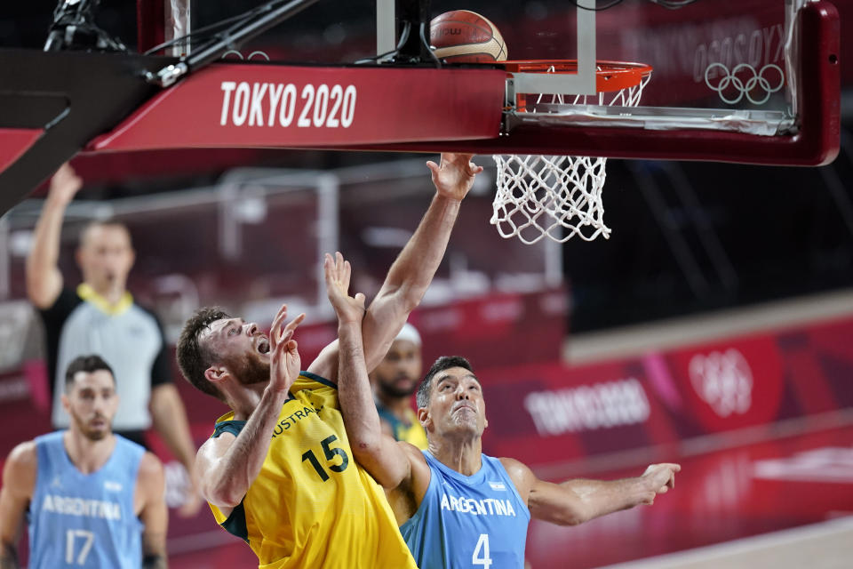 Australia's Nic Kay (15) shoots over Argentina's Luis Scola (4) during a men's basketball quarterfinal round game at the 2020 Summer Olympics, Tuesday, Aug. 3, 2021, in Saitama, Japan. (AP Photo/Charlie Neibergall)