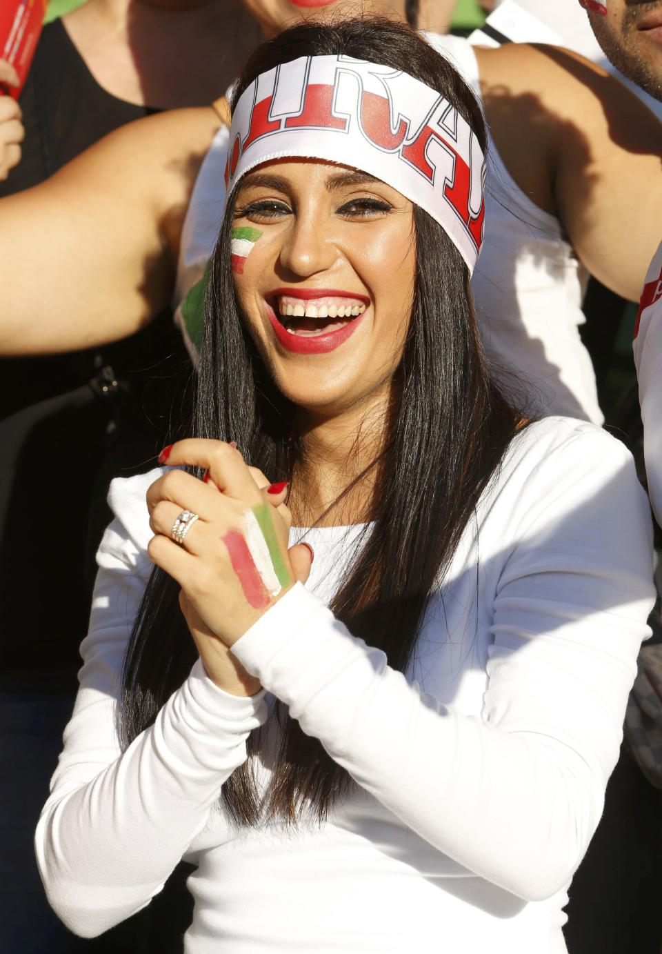 An Iran supporter cheers before the Asian Cup Group C soccer match betweeen Iran and Bahrain at the Rectangular stadium in Melbourne January 11, 2015. REUTERS/Brandon Malone (AUSTRALIA - Tags: SOCCER SPORT)