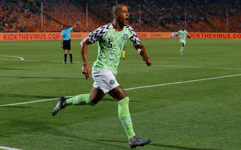 Nigeria's William Troost-Ekong celebrates the winning goal - in the background, a message to 'kick the virus' is broadcast to the world - REUTERS