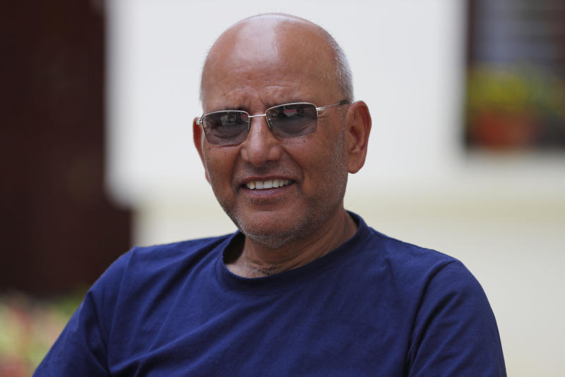 """Puranjan Acharya, an independent analyst, speaks with the Associated Press during an interview at his residence in Kathmandu, Nepal, Friday, May 29, 2020. Nepal's latest border dispute with India, that has strained relations between the two South Asian countries with centuries-old historical, cultural and economical ties, has brought tiny Himalayan nation's bickering political parties together in a rare show of unity. """"It is just not the political parties but the whole population that is backing the government on the issue,"""" said Acharya. (AP Photo/Niranjan Shrestha)"""