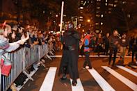 """<p>""""Kylo Ren"""" uses the dark side to get his photo taken in 44th annual Village Halloween Parade in New York City on Oct. 31, 2017. (Photo: Gordon Donovan/Yahoo News) </p>"""