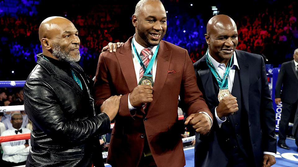 Former heavyweight champions Mike Tyson, Lennox Lewis and Evander Holyfield, pictured here in February.