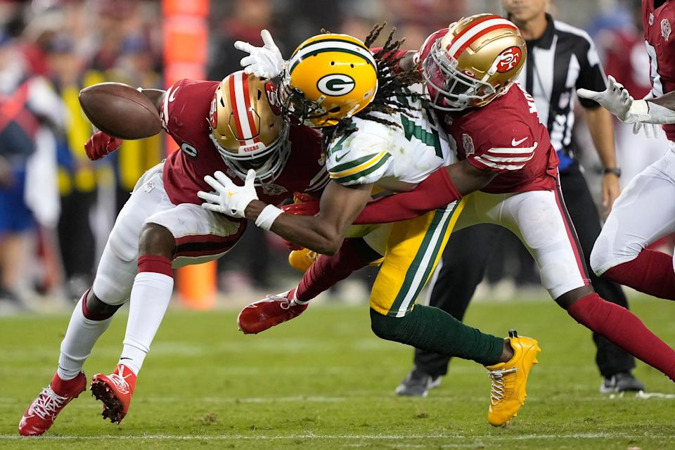 Green Bay Packers wide receiver Davante Adams, middle, cannot catch a pass between San Francisco 49ers cornerback Jimmie Ward, left, and defensive back Emmanuel Moseley during the second half Sunday in Santa Clara, Calif.