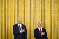 President Joe Biden and Secretary of Homeland Security Alejandro Mayorkas stand during a rendition of the national anthem during a naturalization ceremony in the East Room of the White House, Friday, July 2, 2021, in Washington. (AP Photo/Patrick Semansky)