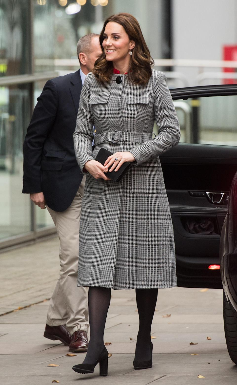 <p>The pregnant royal took a trip up to Manchester, attending the Children's Global Media Summit in a £495 grey L.K. Bennett coat and bright red Goat dress underneath. <i>[Photo: Getty]</i> </p>